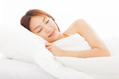young  woman sleeping in the bed Stock Photos