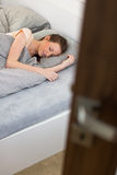 Young woman sleeping in bed Royalty Free Stock Photos