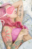 Young woman sleeping in bed with eye mask Stock Photography