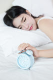 Young woman sleeping on bed f Royalty Free Stock Photos