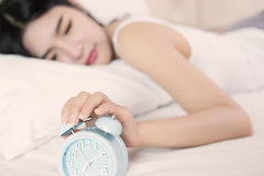 Young woman sleeping on bed f Royalty Free Stock Images