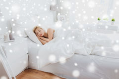 Young woman sleeping in bed at home bedroom Stock Image