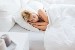 Young woman sleeping in bed at home bedroom Stock Images