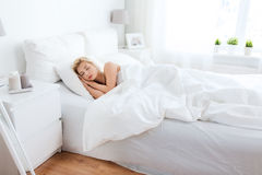 Young woman sleeping in bed at home bedroom Royalty Free Stock Image