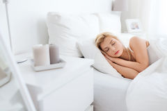 Young woman sleeping in bed at home bedroom Royalty Free Stock Photography