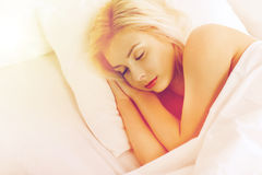 Young woman sleeping in bed at home bedroom Stock Photography