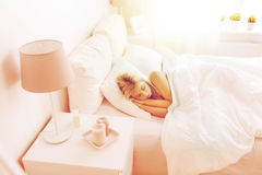 Young woman sleeping in bed at home bedroom Royalty Free Stock Photo