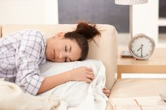 Young woman sleeping in bed in the morning Royalty Free Stock Photography