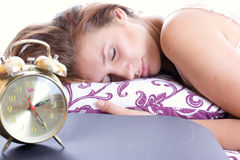 Young woman sleeping in bed in the morning. Royalty Free Stock Images