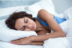 Young woman sleeping on bed Royalty Free Stock Image