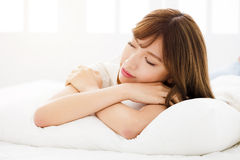 Young woman sleeping in bedroom Royalty Free Stock Photo