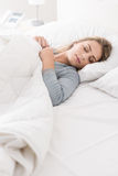 Young woman sleeping in the bedroom stock images
