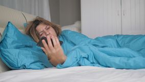 Really Sleeping Woman Wakes Up And Looks At The Phone Throws It And Falls Asleep royalty free stock photos