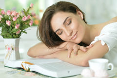 Young woman sleeping on book Stock Image
