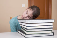Young woman sleeping on books Royalty Free Stock Photography