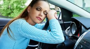 Young woman sleeping in a car Royalty Free Stock Photography