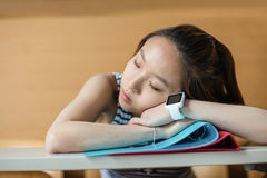 Young woman sleeping in classroom Stock Photo