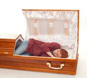 Young woman sleeping in the coffin Royalty Free Stock Photo