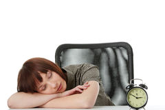 Young woman sleeping on desk Royalty Free Stock Photography