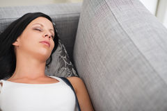 Young woman sleeping on divan Royalty Free Stock Photo