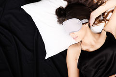 Young woman sleeping with Eyeshades. A young woman sleeping with a eye covering mask Royalty Free Stock Photography
