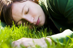 Young woman sleeping on the grass. Young woman dreaming on the grass stock photos