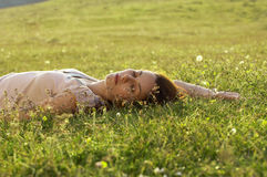 Young Woman Sleeping On Grass At Park Royalty Free Stock Photo