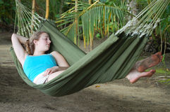 Young woman sleeping in a hammock Royalty Free Stock Images
