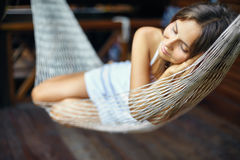 Young woman sleeping in a hammock Royalty Free Stock Photos