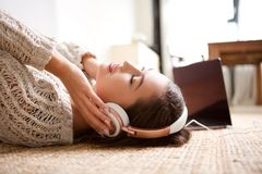 Young woman sleeping with headphones. Side portrait of young woman sleeping with headphones Royalty Free Stock Photo