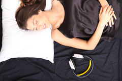 Young woman sleeping with headset Stock Photos