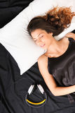 Young woman sleeping with headset Stock Photography