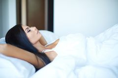 Young woman sleeping on her back in bed Royalty Free Stock Photo