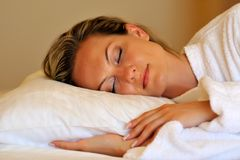 Young woman sleeping in her bed Stock Photo