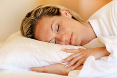 Young woman sleeping in her bed Stock Photos