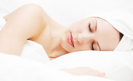 Young woman sleeping in her bed Royalty Free Stock Image