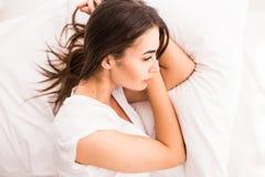Young woman sleeping in her bedroom Stock Photos