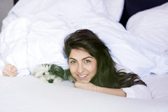 Young woman sleeping with her dog on a bed. Royalty Free Stock Photo