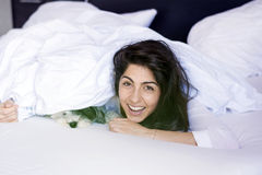 Young woman sleeping with her dog on a bed. Stock Image