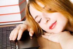Young woman sleeping at her workplace Stock Photo
