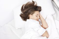 Young Woman Sleeping In Bed Royalty Free Stock Photo