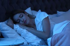 Free Young Woman Sleeping In Bed At Night Stock Photos - 120706243