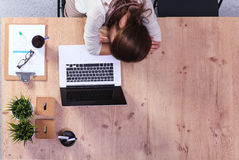 Young woman sleeping on laptop in the workplace Stock Photography