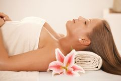 Young woman sleeping on massage bed Royalty Free Stock Photography