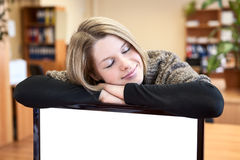 Young woman sleeping over blank screen Royalty Free Stock Images