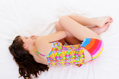 Young woman sleeping snuggle in bed Stock Images