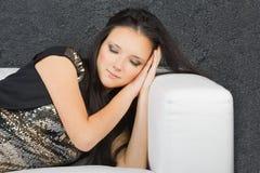 Young woman sleeping on a sofa Stock Image