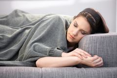 Young woman sleeping on sofa Royalty Free Stock Image