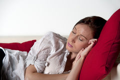 Young woman sleeping on a sofa Royalty Free Stock Images