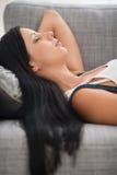 Young woman sleeping on sofa Stock Photos